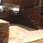 Stone work complemented by reclaimed hardwood screen