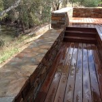 Stone wall and hardwood decking with river views