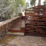 Sandstone paving and hardwood decking with river views