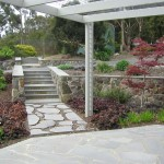 Timber pegola, random sawn bluestone paving
