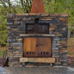 Outdoor fireplace and oven with steel doors