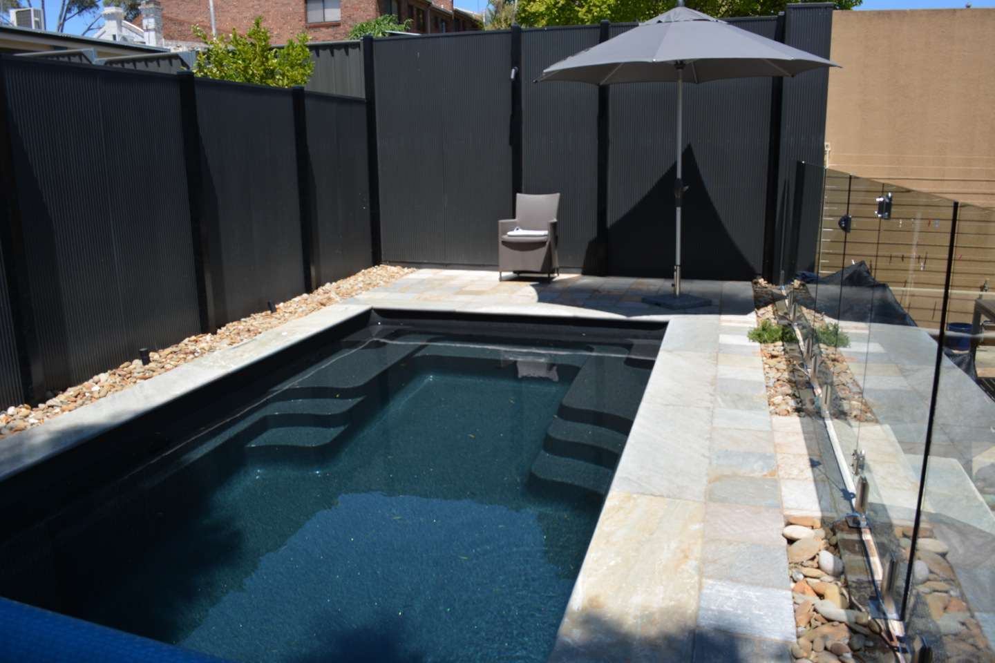Swim-spa pool with Oyster marble copping and paving