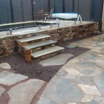 Yapeen sandstone walls , Oyster marble random paving and Glass pool fencing