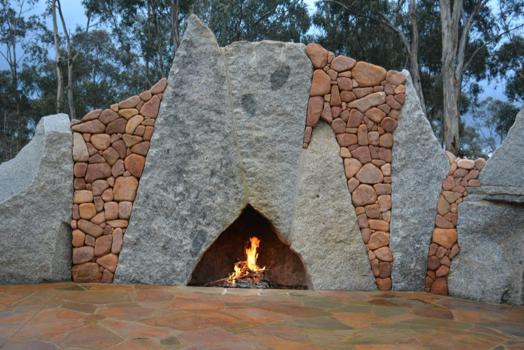 Large Granite torrs framed with pink River stone