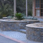 Stone retainer walls and bronze fountain